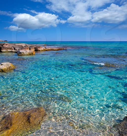 Formentera Mitjorn south beach with turquoise Mediterranean at Balearic Islands photo