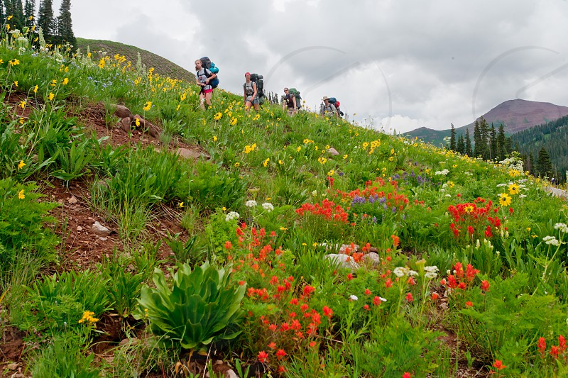 Family backpacking Maroon Pass Trail near Crested Butte Colorado photo