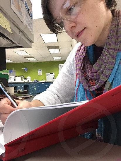 woman wiring on her notebook photo