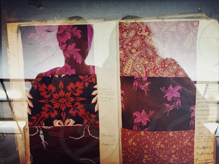 red paisley cloth on a frame photo