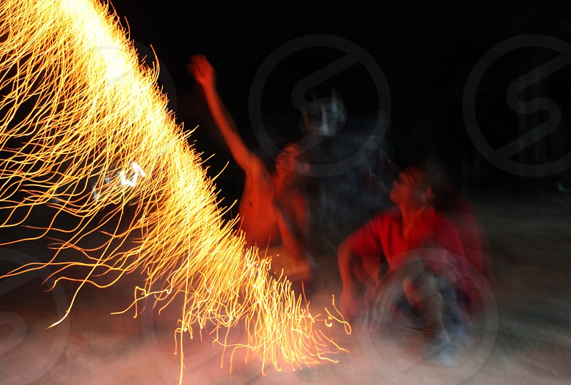 people play with firework near the city of Amnat Charoen in the Region of Isan in Northeast Thailand in Thailand. photo