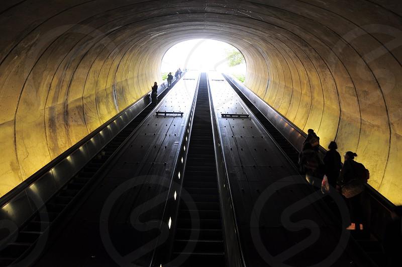 people taking escalator photo