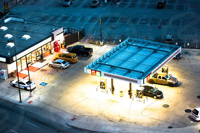 Convenience store Dallas Texas parking lot view from above lights night grass station fuel photo