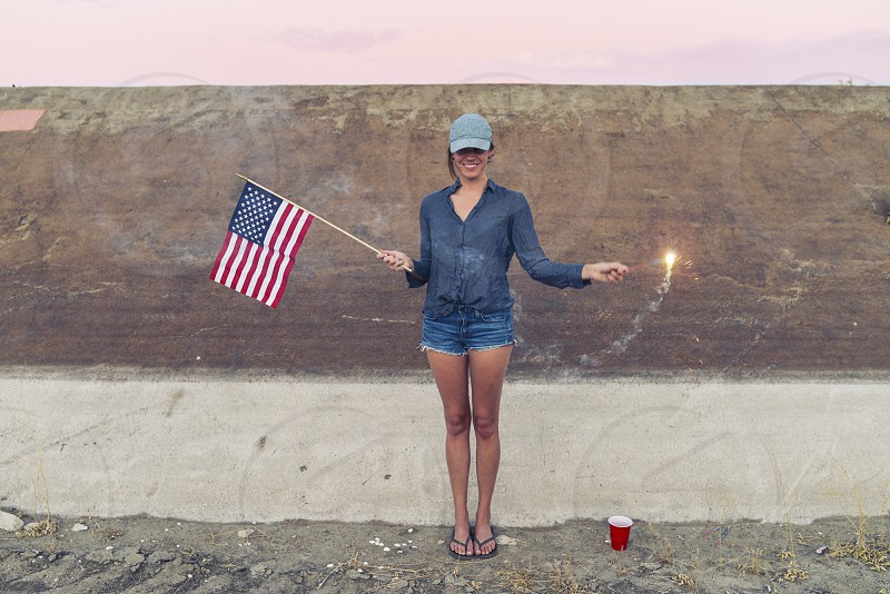 girl on fourth of july with sparkler photo