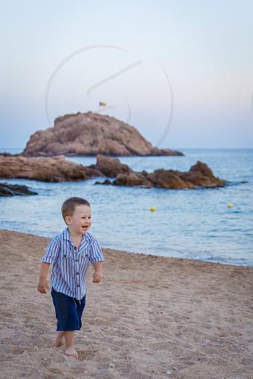 Spain holiday fun beach smile kid Tossa de Mar photo