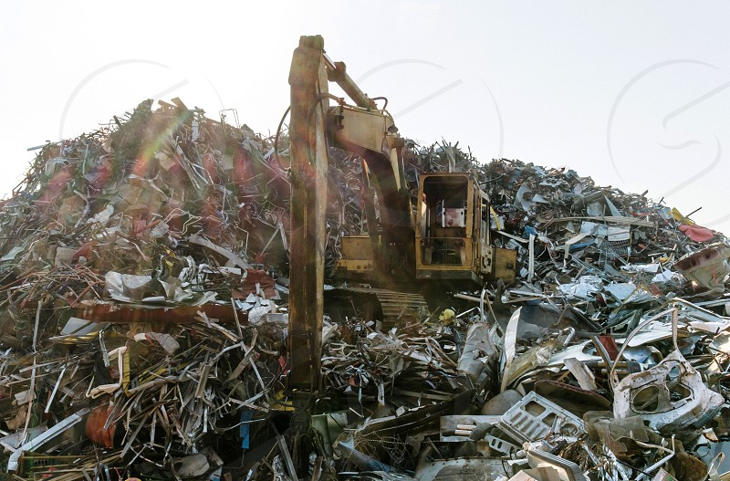Backhoe on the recycle able mountain photo