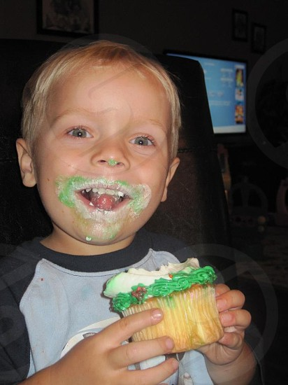 boy holding cupcake photo