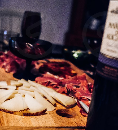 Cheese cold cuts wine wooden table close up  manchego  Spanish cheese photo