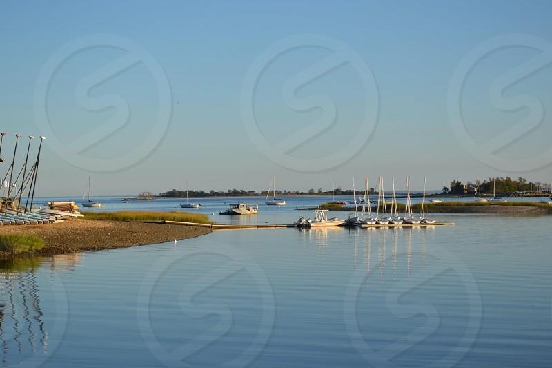 beach and boats docked photo