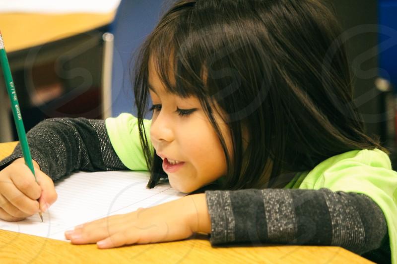 Kindergartner practicing her writing photo
