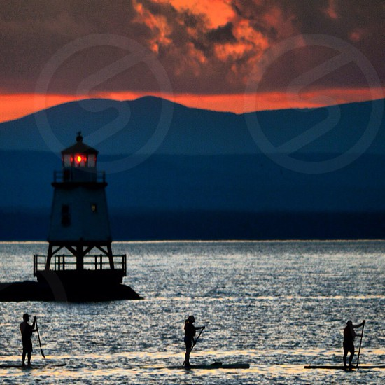light house lake champlain at sunset photo