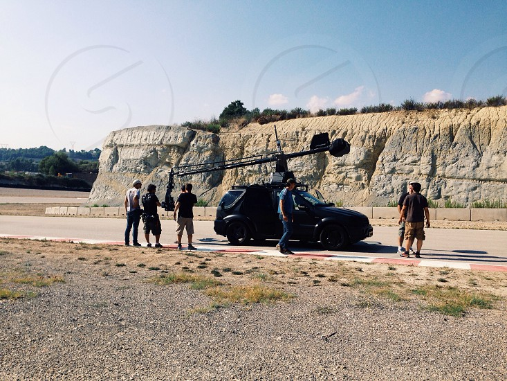 Film crew and Russian arm on a racetrack photo