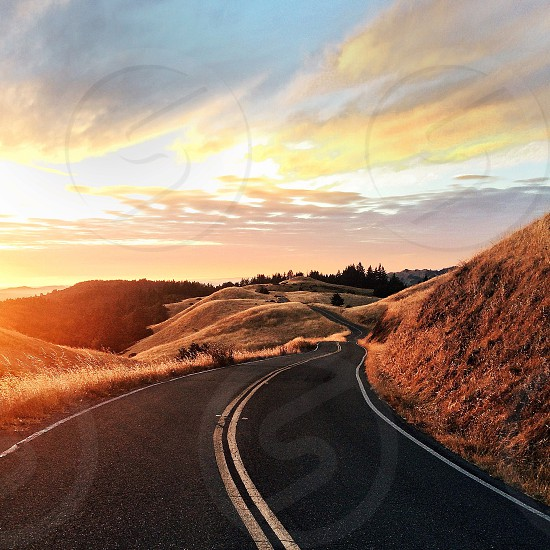 asphalt road way beside mountain nature photography photo