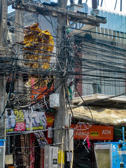 THAILAND PHUKET - MARCH 26 2012: Chaos of cables and wires on an electric pole photo