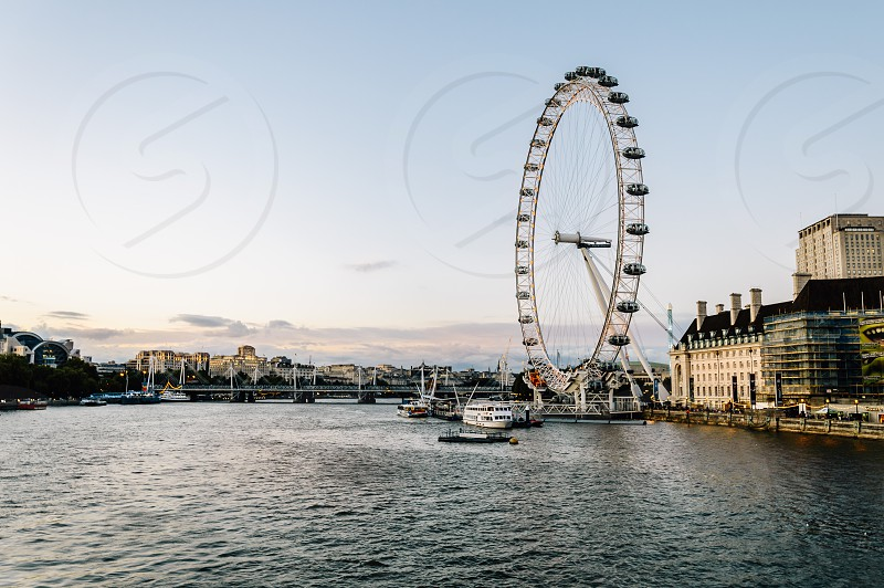 London skyline in the evening. With Sea Aquarium and The London Eye on River Thames photo