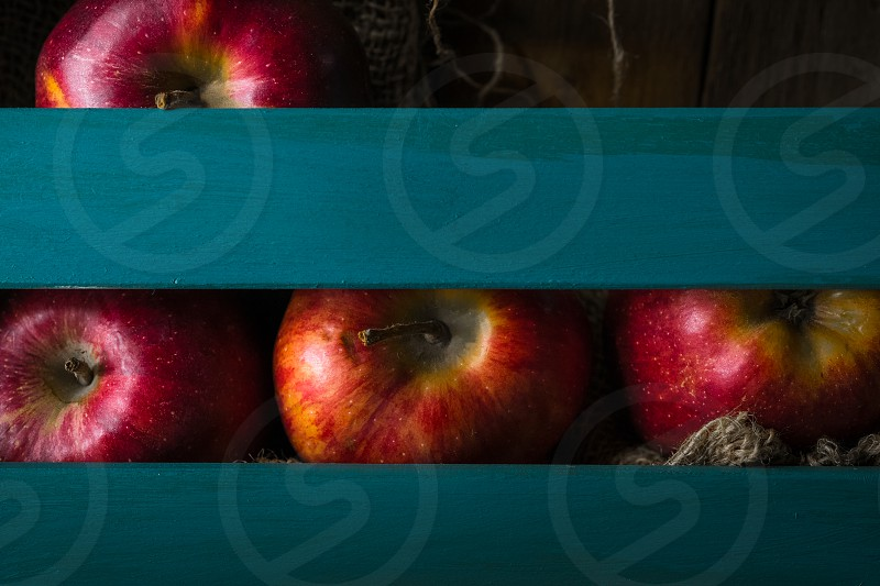 Red apples in a wooden box photo