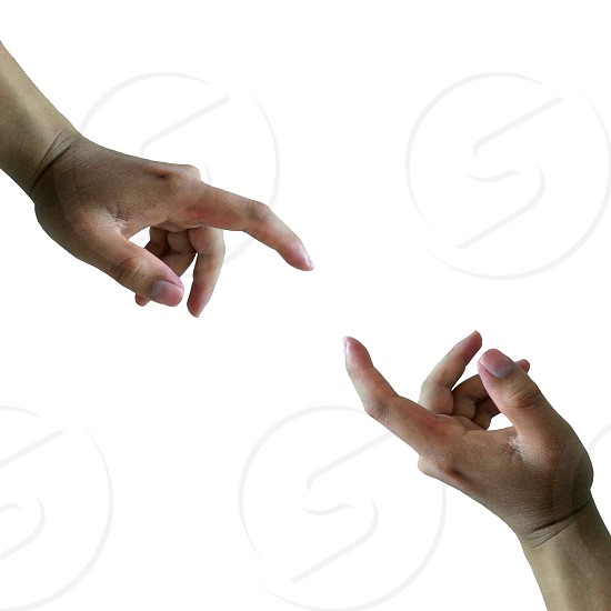 person's left hand index and thumb about to touch other hand photo