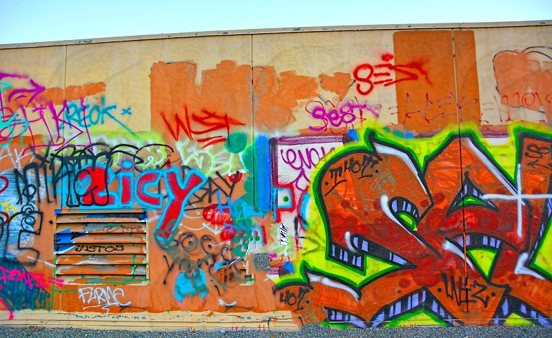 Colorful graffiti on an urban street wall photo