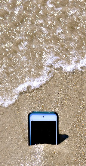 iPhone in the sand photo