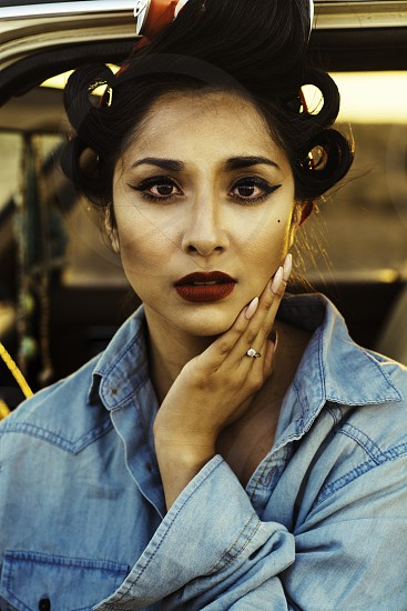 girl sitting in vintage car with a pin up style photo