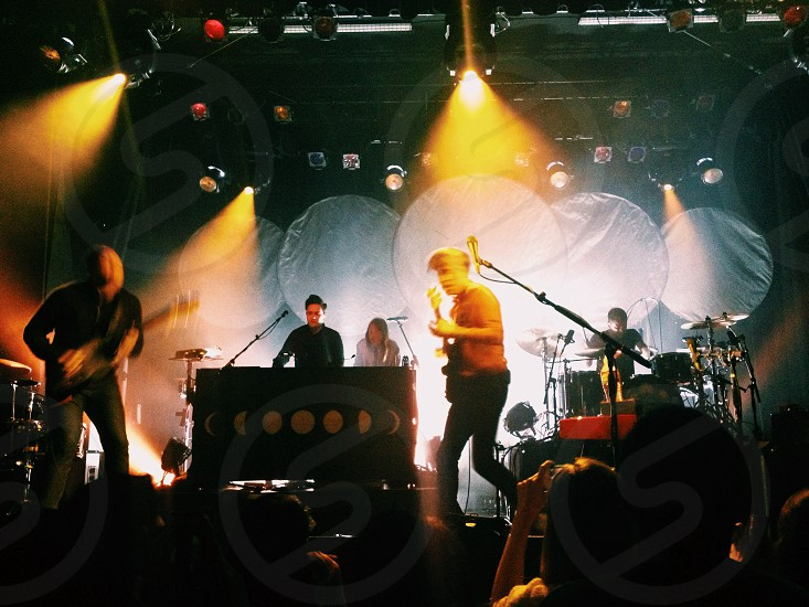 band performing on stage photo