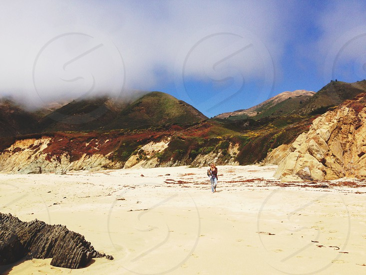 sand beach with mountains photo