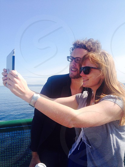 man and woman taking selfie photo