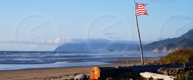 We made it to the Pacific Northwest! Driftwood-masted American Flag. Arch Cape OR photo