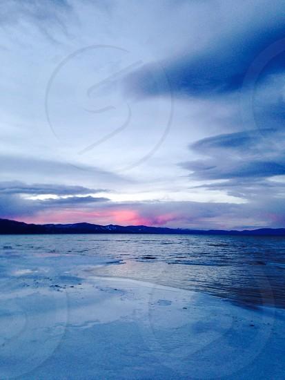 Sunset over frozen Lake Tahoe photo