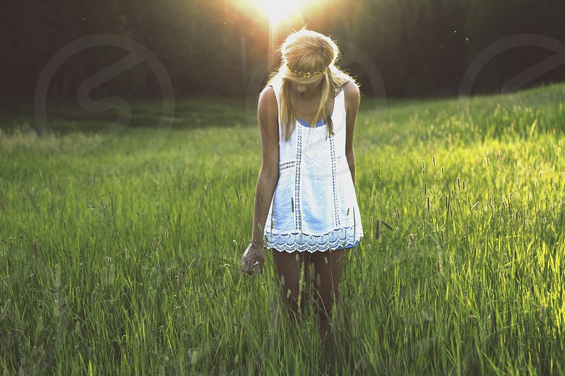 woman standing on grassy field photo
