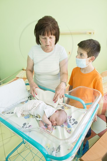 Newborn baby in a hospital. Baby room photo