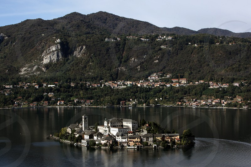 The Isla San Giulio in the Ortasee outside of the Fishingvillage of Orta on the Lake Orta in the Lombardia  in north Italy.  photo