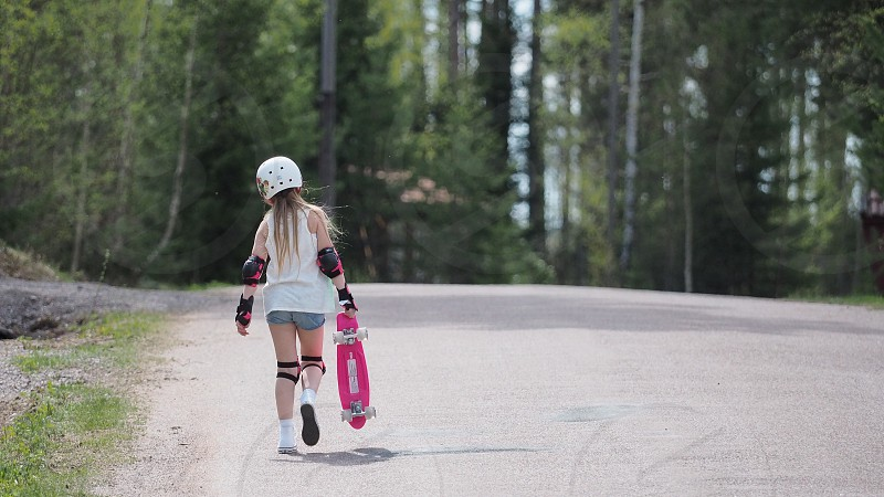 Girl helmet skate board protected pink road Sweden countryside playing child photo