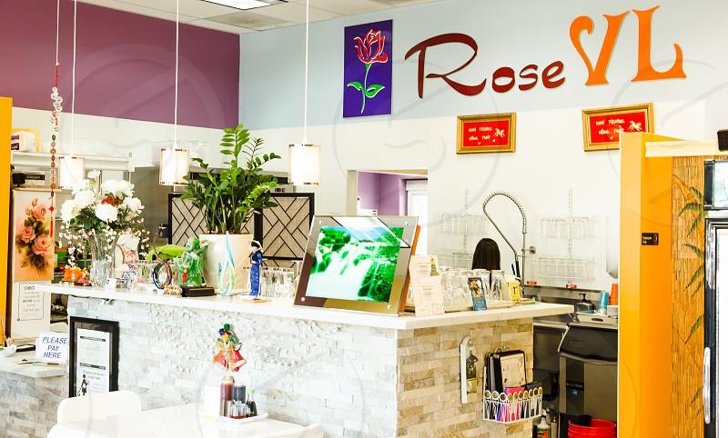brown photo frame on counter beside rose vl sticker signage inside room photo