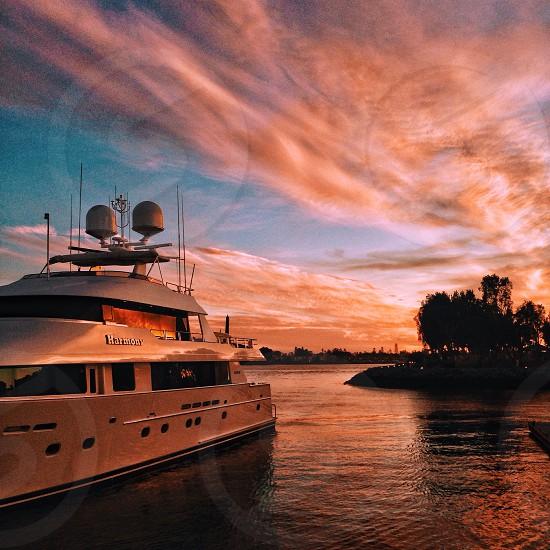 white yacht in lake dusk   photo