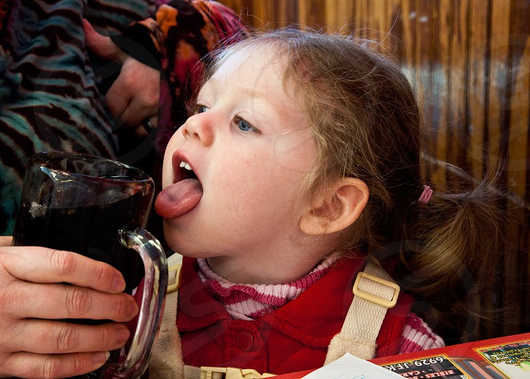 Little Girl Drinking Root Beer photo