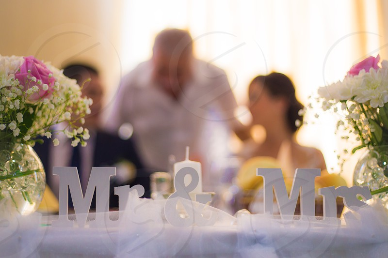 white wooden mr & mrs free standing letter with a background of man and woman photo