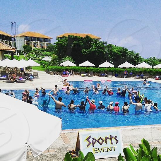 people in swimming pool photo