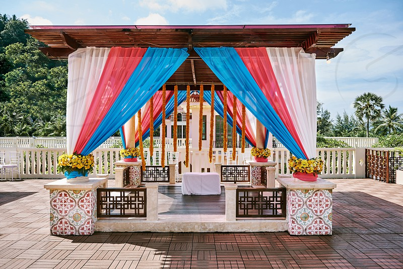 The colourful decoration of indian wedding venue for mehndi (henna) Ritual ceremony Puja (Pooja) thread ceremony. photo