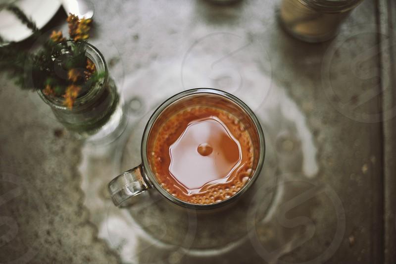 espresso in a glass mug on a glass plate photo