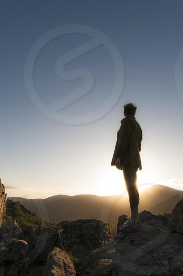 woman girl young silhouette backlit climber climbing sport top mountain effort sky sunset sunrise verticall photo