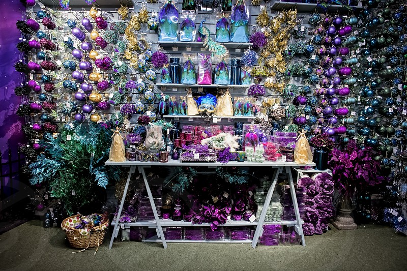 purple and turquoise Christmas decor to sale in a display photo