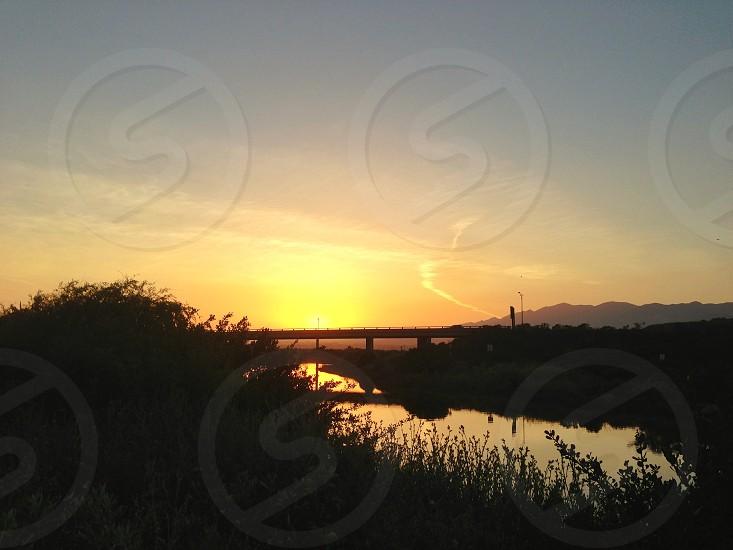 Sunset water bridge photo