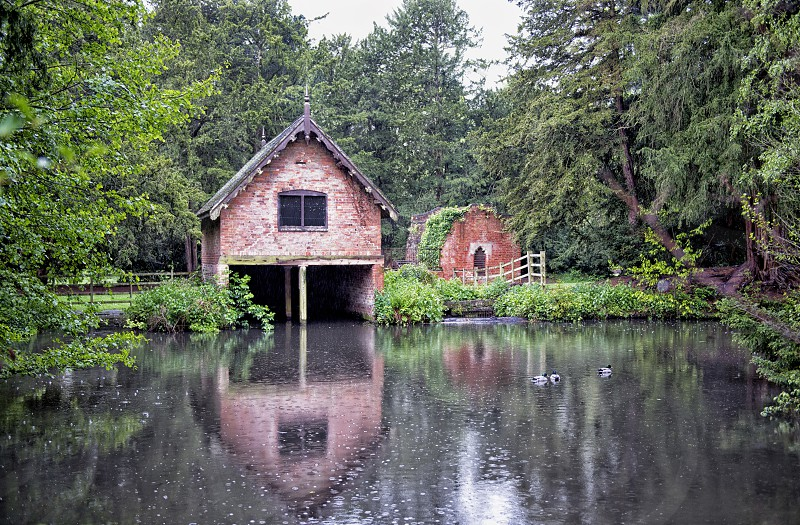 brown wooden house and near body of water photo