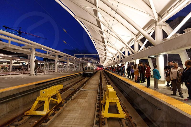 Passengers waiting on rail platform at Union Station in Denver Colorado. photo