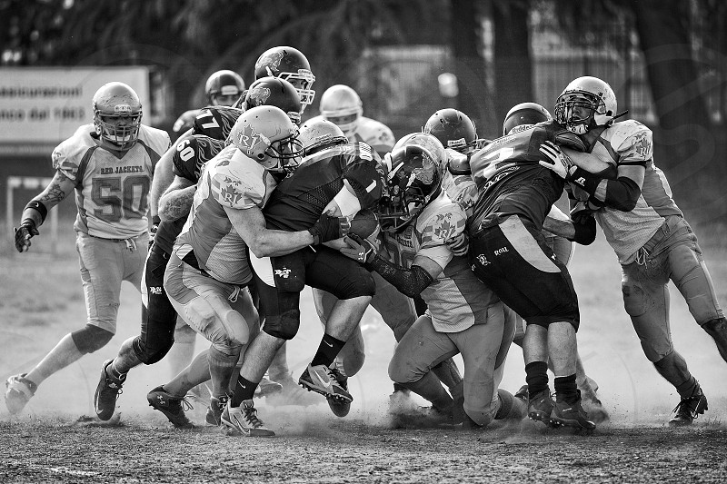 America football shot in black and white in the dust photo