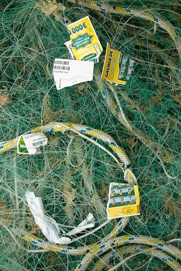 Fishing line and a losing lottery ticket St. Vaast (Normandy) France. photo