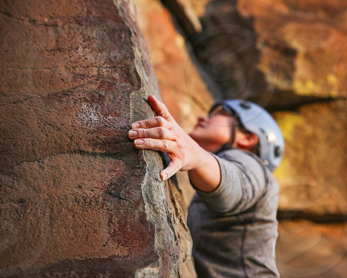 a girl rock climbing photo