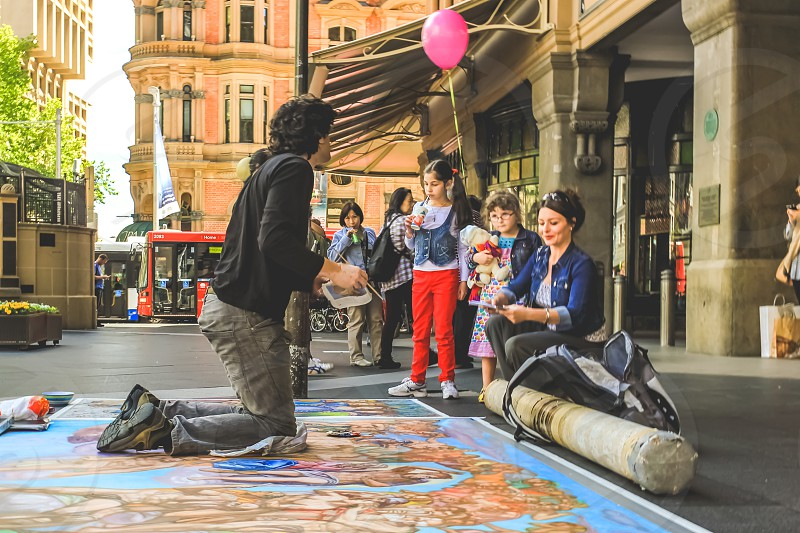 artist decorating the street outside the Queen Victoria Building in Sydney Australia  photo