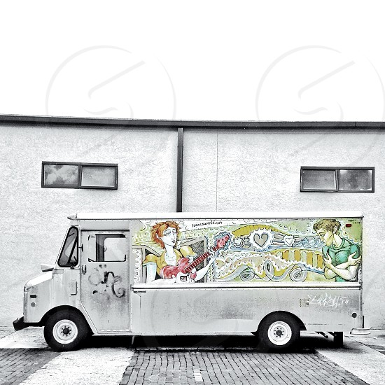 white bus with people painted on it photo